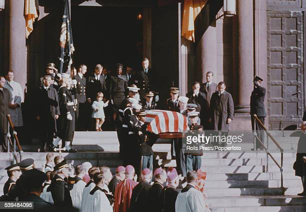View of the flag draped casket carrying the body of President John F Kennedy being carried down the front steps of St Matthews Cathedral in...