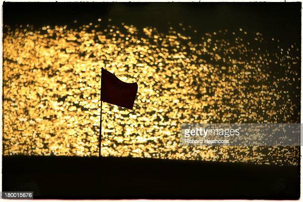 View of the flag on the 13th green with the shimmering lake behind during the first round of the Omega European Masters at the Crans-sur-Sierre Golf...