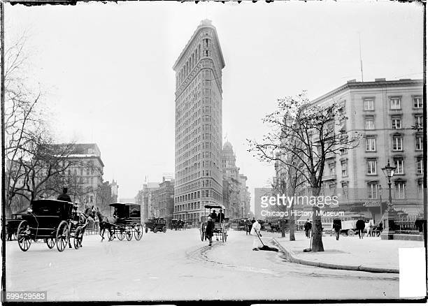 View of the Flatiron Building New York New York October 1903 Horse drawn carriages pedestrians and a street cleaner are visible Photo was taken...