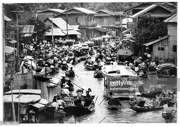 A view of The floating markets on Klongs or water streets of Bangkok Thailand