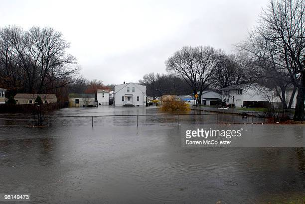A view of the flooded Perkins Street neighborhood is seen as the Pawtuxett River over flows causing evacutions March 30 2010 in Cranston Rhode Island...