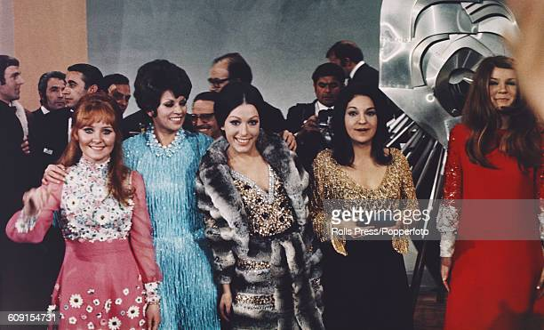 View of the four joint winners of the 1969 Eurovision Song Contest pictured together with the retiring 1968 winner Massiel of Spain from left to...