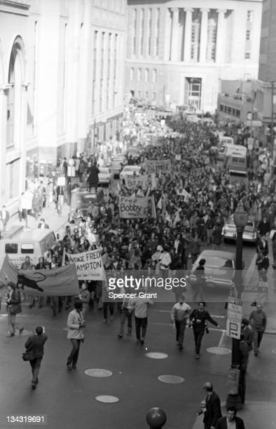 View of the 'Free Fred Hampton' parademarching in downtown Boston's Arch Street 1970