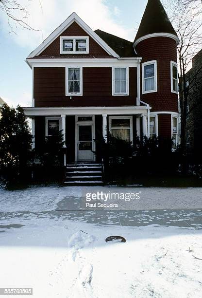View of the front facade of a house with snow on the sidewalk and front yard on Paulina Street in a north side neighborhood Chicago Illinois 1983