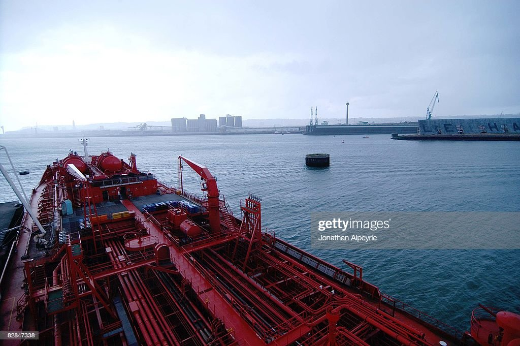 A view of the front half of the Jo Tanker getting its load of NAFTA (fuel used for aircrafts) at the French port before heading towards America, on July 10, 2008, in France. The Jo Tanker is a Norwegian owned ship, but using a Dutch flag and officer core.