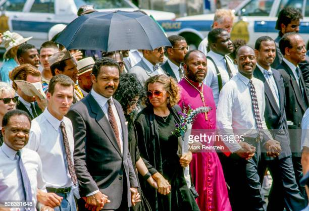 View of the front line of homeless activist Mitch Snyder's funeral procession near Freedom Plaza on Pennsylvania Avenue NW Washington DC July 10 1990...
