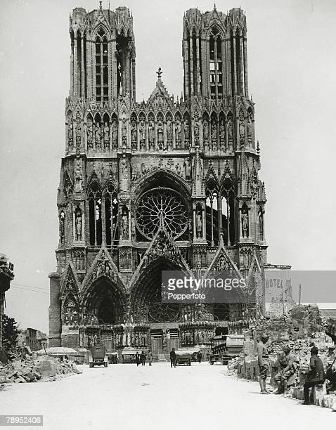 circa 1940 France A view of the front of Rheims Cathedral showing bomb damage inside and outside the ornate structure