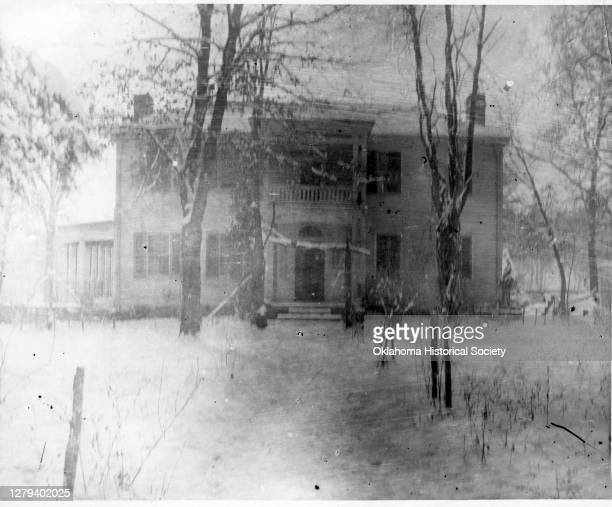 View of the front of the George M Murrell Home in winter, Park Hill, Indian Territory, between 1896 and 1906.
