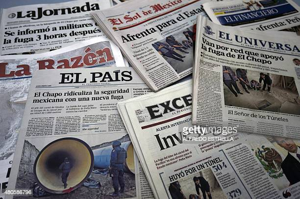 """View of the front pages of several newpapers in Mexico City on July 13 reading about Mexican drug lord Joaquin """"El Chapo"""" Guzman's escape from the..."""