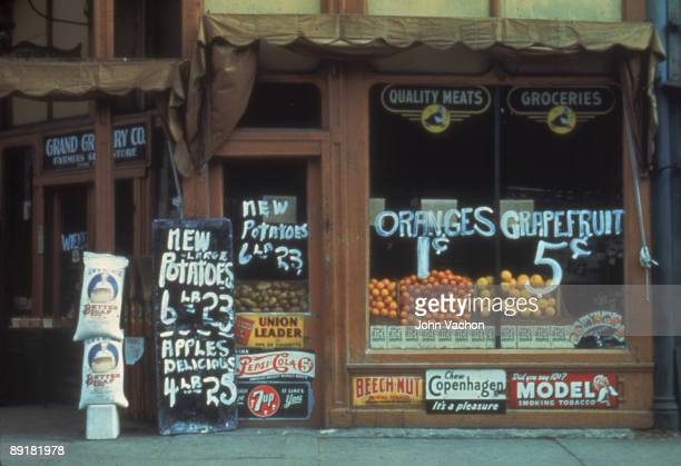 View of the front window of the Grand Grocery Company which advertises potatoes oranges and grapefruit among other items Lincoln Nebraska 1942