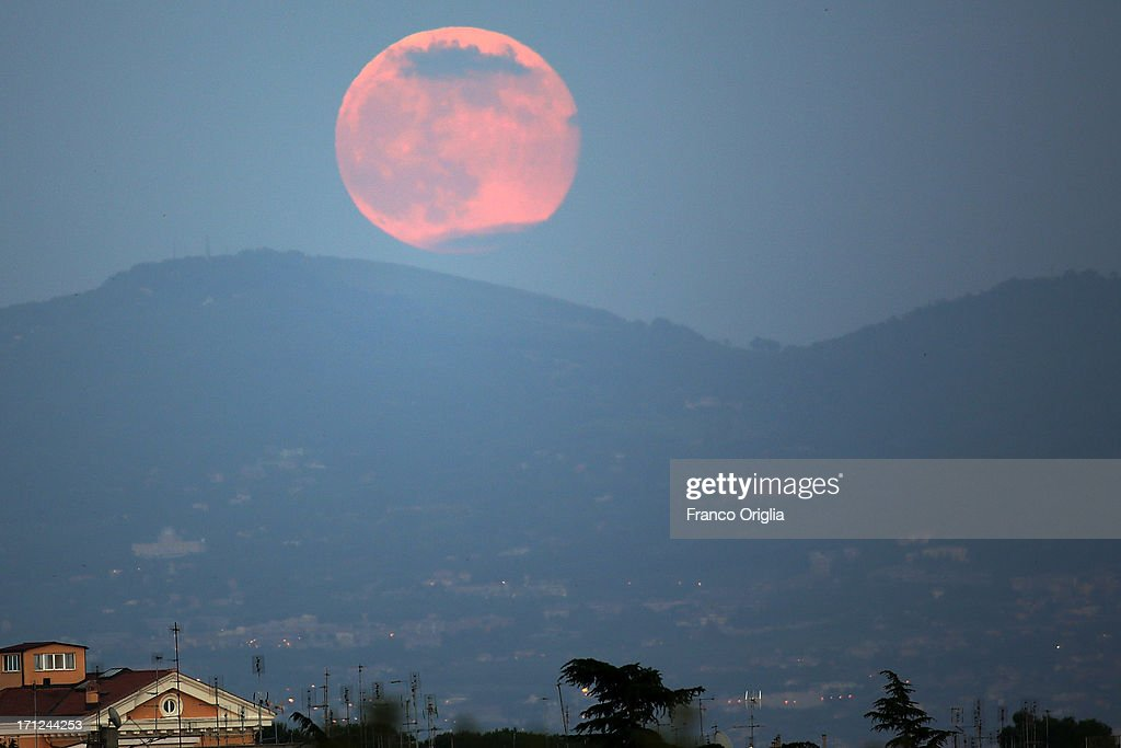 A view of the full moon over the sky of Rome on June 23, 2013 in Rome, Italy. Tonight a pink full moon was expected to appear in the sky of Rome. The event occurs once a year when the moon reaches its nearest point to Earth, making it appear much larger than usual as well as being a peculiar shade of pink. The spectacle can be seen throughout the world, weather permitting.