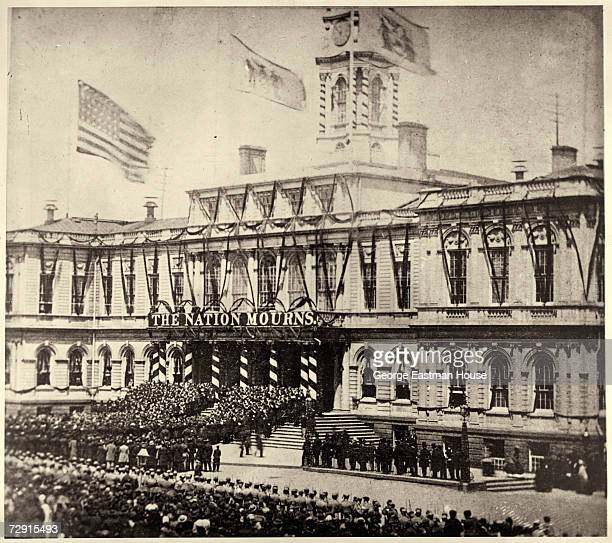View of the funeral procession of assassinated American President Abraham Lincoln as arrives at City Hall New York New York April 25 1865 A banner...