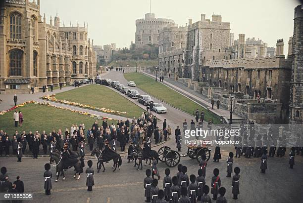 View of the funeral procession of Field Marshal William Slim, 1st Viscount Slim as the casket, lying on a gun carriage, is pulled by six horses along...