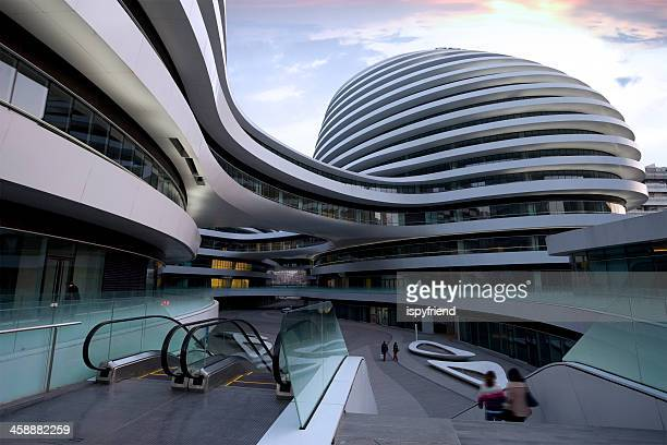 view of the galaxy soho, beijing,china - futurism stock photos and pictures