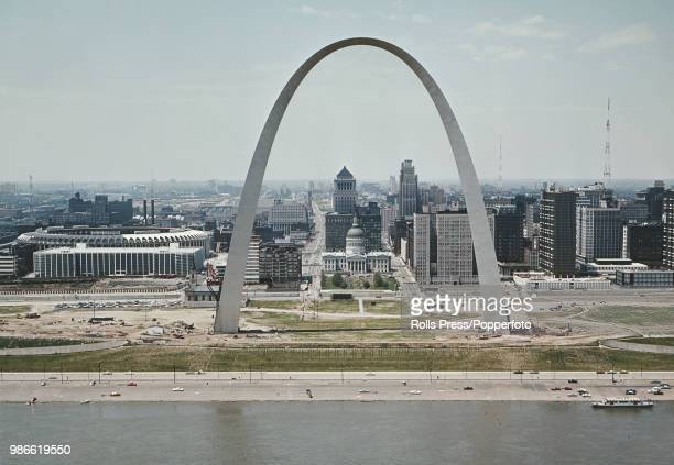 View of the Gateway Arch monument Busch Memorial Stadium and downtown St Louis with the Mississippi River in the foreground in the state of Missouri...