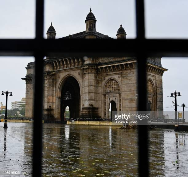 View of the Gateway of India through the iron barricades on August 21, 2020 in Mumbai, India.