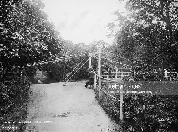 A view of the General's Well iron suspension footbridge connecting the Ness Islands in the River Ness Inverness Scotland circa 1890