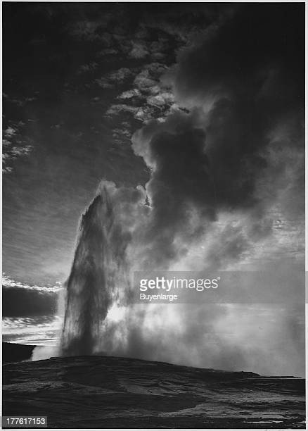 View of the geyser 'Old Faithful' during eruption taken at dusk or dawn from various angles Yellowstone National Park Wyoming 1942
