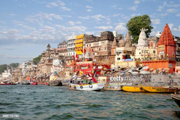 a view of the ghats of varanasi india from the ganges river. - varanasi stock pictures, royalty-free photos & images