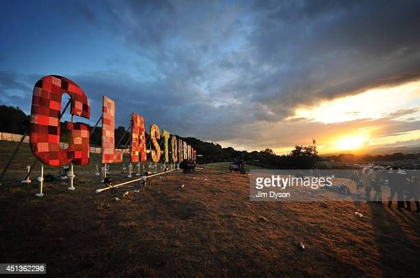 A view of the Glastonbury sign at sunset during Day One of the Glastonbury Festival at Worthy Farm in Pilton on June 27 2014 in Glastonbury England...