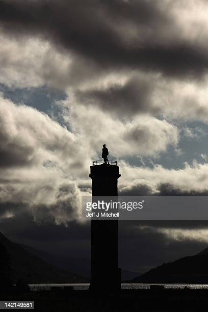 A view of the Glenfinnan Monument with Loch Shiel behind on March 30 2012 in Glenfinnan Scotland The monument was built in 1815 to mark the place...