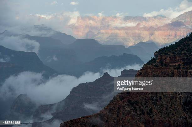 View of the Grand Canyon from Mather Point on the South Rim with clouds rising after a thunderstorm near the Grand Canyon Visitor Center in the Grand...