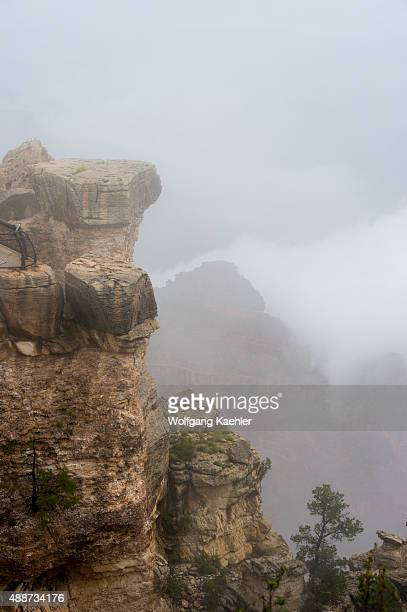 View of the Grand Canyon rock formations with clouds from Mather Point on the South Rim during a thunderstorm near the Grand Canyon Visitor Center in...