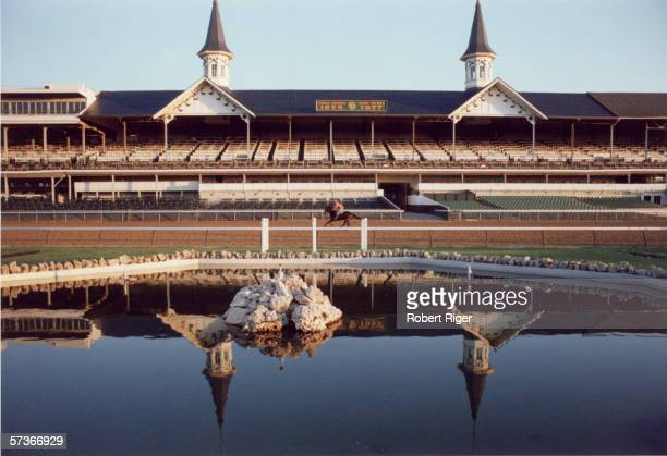 View of the grandstand at the Churchill Downs race track as a jockey works out a horse prior to the Kentucky Derby, Louisville, Kentucky, 1978.
