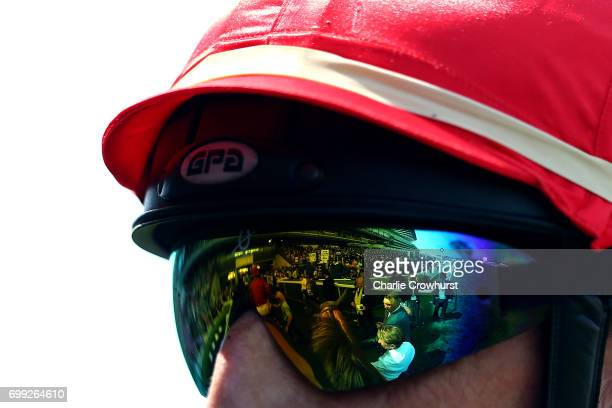 A view of the grandstand is seen in the reflection of a jockeys goggles during day 2 of Royal Ascot at Ascot Racecourse on June 21 2017 in Ascot...