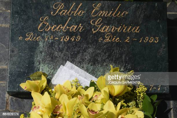 View of the grave of druglord Pablo Escobar on the 24th anniversary of his death at the Montesacro cemetery in Itagui near Medellin Antioquia...