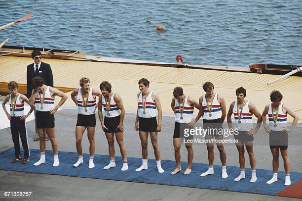View of the Great Britain men's eights rowing team pictured on the podium with their silver medals after finishing in second place in the Men's...