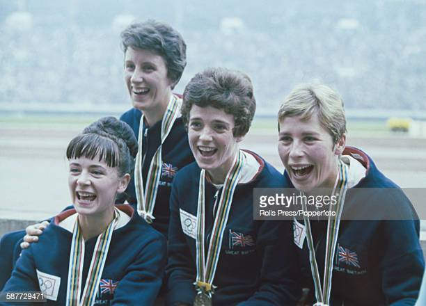 View of the Great Britain team third place winners of the women's 4 x 100 metres relay competition pictured with their bronze medals at the 1964...