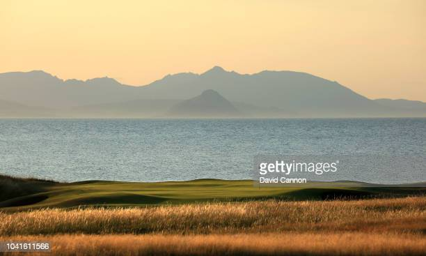 A view of the green on the par 5 10th hole on the Ailsa Course with the island of Arran behind at the Trump Turnberry Resort on July 29 2018 in...