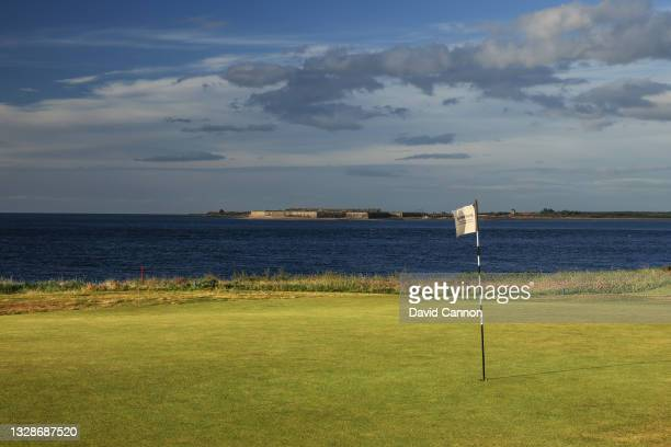 View of the green on the par four third hole looking across the Moray Firth to Fort George at Fortrose & Rosemarkie Golf Club on June 17, 2021 in...