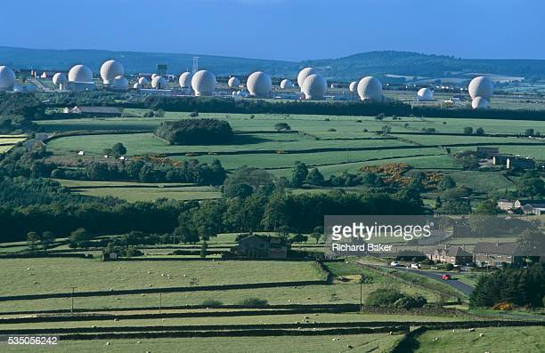 A view of the green Yorkshire moors countryside looking down from a nearby hill to the top secret intelligencegathering base of RAF Menwith Hill near...