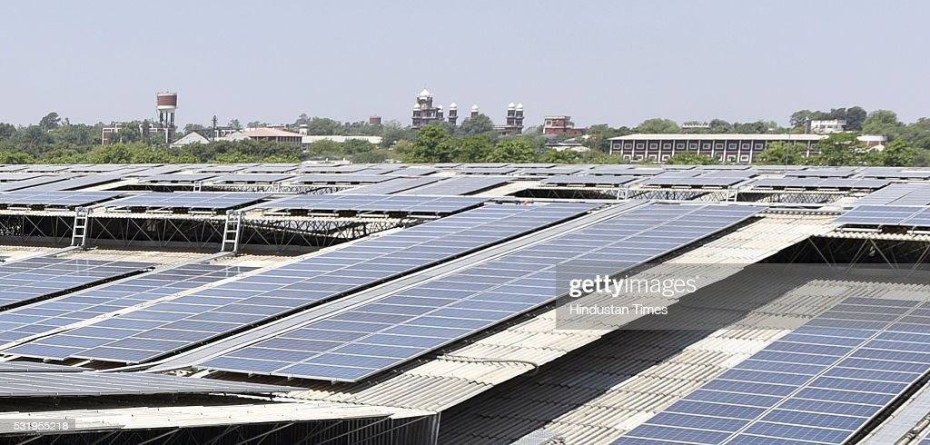 A view of the Guru ji temple just behind the world`s largest Rooftop Solar Photovoltaic Power plant 115 MW installed on single roof at Dera Baba...