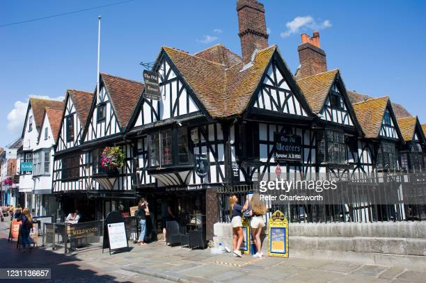 View of the half timbered Old Weavers House restaurant on the High Street on a summer's day. The building dates back to the turn of the 16th century.