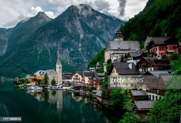 View of the Hallstatt village, a World Heritage-listed town on Lake Hallstatt's western shore in Austria's mountainous Salzkammergut region in...