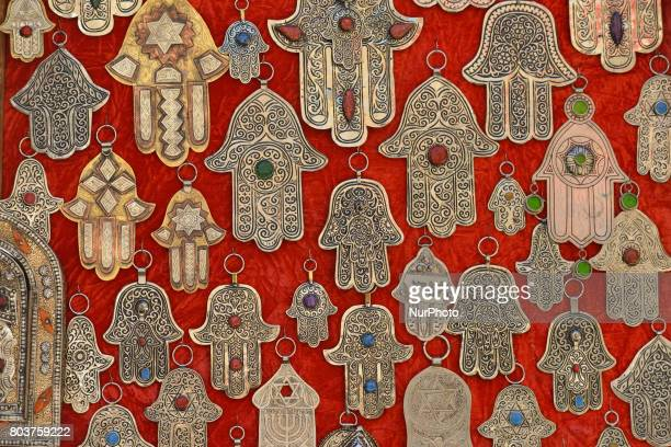 A view of the Hamsa a palmshaped amulet jewlery seen on display for sale inside Fes medina On Thursday June 29 in Fes Morocco