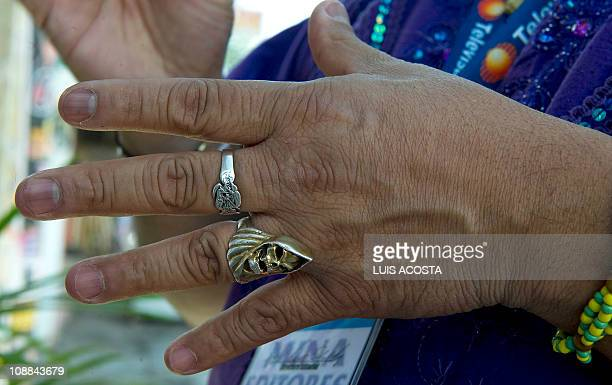 PINEDA View of the hand of Martin George priest of the Holy Death cult as he prays in a shrine in the Municipality of Chalco 40 km east of Mexico...