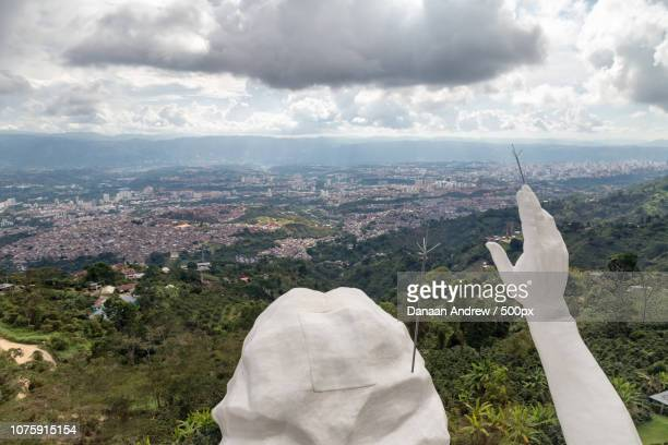 View of the hands and head of the El Santisimo Jesus Statue above Bucaramanga, Colombia.