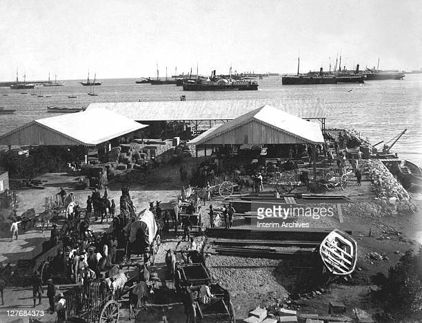 View of the harbor and principal wharf in the city of Ponce, on Puerto Rico, an island which, at the conclusion of the Spanish American War, Spain...