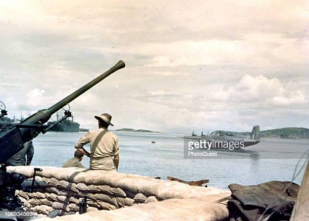 View of the harbor at Port Moresby Papua New Guinea April 26 1943 Visible past the Bofors gun at left is a Short Sunderland flying boat patrol bomber...