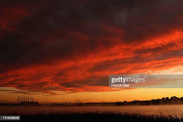 A view of the Hazelwood Power Station across the cooling pondage at sunrise on March 21 2012 in Melbourne Australia The brown coal fueled power...