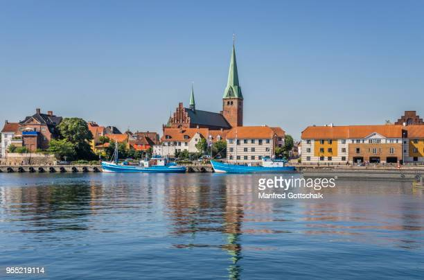 view of the helsingor harbourfront with the tower of saint olaf's church rising over the town roofs, helsingør, zealand, denmark - helsingor stock pictures, royalty-free photos & images