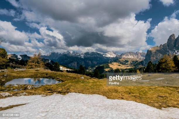 view of the high mountains of grohmannspitz with pass sella, dolomites, european alps, italy - pavliha stock photos and pictures
