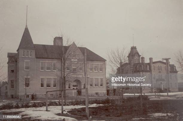 View of the high school and grade school Black River Falls Wisconsin 1900 The older building on the right originally held both high school and...