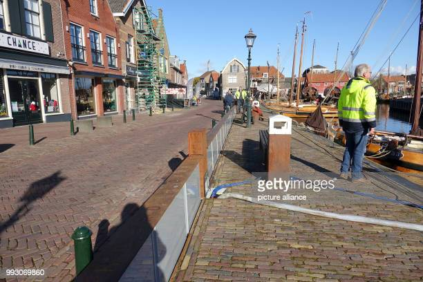 View of the hightech dique at the historical harbour of Spakenburg Netherlands 6 November 2017 The super dique can be extended up to 80 centimeters...