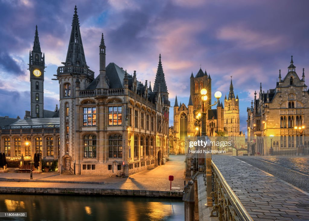 View of the historic area of Graslei and bell tower at River Leie and bridge Sint-Michielsplein at dusk, Ghent, Belgium : ストックフォト