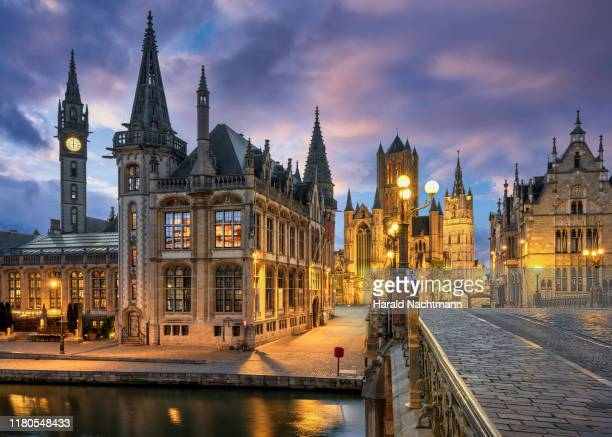view of the historic area of graslei and bell tower at river leie and bridge sint-michielsplein at dusk, ghent, belgium - belgium ストックフォトと画像